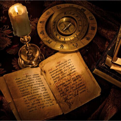 świeca, magiczna księga, znaki zodiaku, kompas